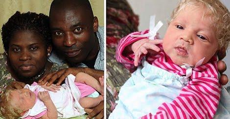 Padres negros con bebé blanco